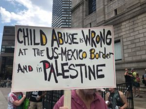 "Sign says ""Child abuse is wrong at the US-Mexico Border and in Palestine"""
